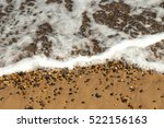 Ocean Wave Washes Over Sand An...
