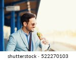 young businessman is eating... | Shutterstock . vector #522270103