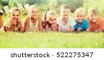 positive friends lying on green ... | Shutterstock . vector #522275347