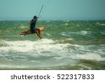 a kitesurfer makes a difficult... | Shutterstock . vector #522317833