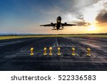 Small photo of Runway, airstrip in the airport terminal with marking on blue sky with clouds background. Travel aviation concept.