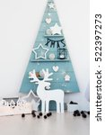 Small photo of Christmas decorations christmas stylish. Blue wood tree with lights and other decoration, deer, stars and cones.