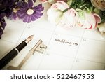 word wedding on calendar with... | Shutterstock . vector #522467953