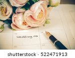 word wedding on calendar with... | Shutterstock . vector #522471913