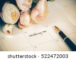 word wedding on calendar with... | Shutterstock . vector #522472003