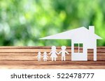 paper family on wooden table... | Shutterstock . vector #522478777