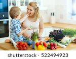 mother and child preparing... | Shutterstock . vector #522494923