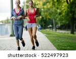 two women jogging in park and... | Shutterstock . vector #522497923