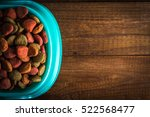 dog food in a bowl on wooden... | Shutterstock . vector #522568477