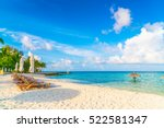 beach chairs with umbrella at... | Shutterstock . vector #522581347