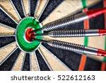 three darts in bull's eye