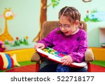cute girl in wheelchair playing ... | Shutterstock . vector #522718177