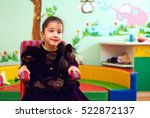 cute little girl in wheelchair...   Shutterstock . vector #522872137