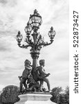 Small photo of PARIS, FRANCE, on JULY 10, 2016. Architectural details of a decor of Alexander III Bridge. Beautiful streetlight