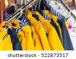 bright autumn raincoats hanging ... | Shutterstock . vector #522873517