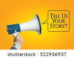 Small photo of Hand with megaphone, Hand with loudspeaker, with words TELL US YOUR STORY