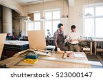 happy male carpenter showing... | Shutterstock . vector #523000147