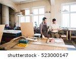 happy male carpenter showing... | Shutterstock . vector #523000147