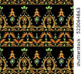 seamless paisley pattern ... | Shutterstock .eps vector #523064863