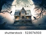Haunted house with full moon in ...