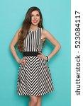 Fashion Model In Striped Dress...