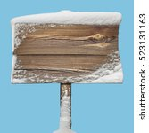 Wooden signpost with snow on it ...