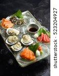 raw oyster  salmon  tuna ... | Shutterstock . vector #523204927