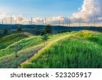 Windmills In Sunset Time Sky A...