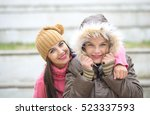 Two Cheerful Cute Girls  One...