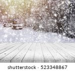 wood table top on winter trees... | Shutterstock . vector #523348867