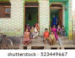 indian family on his doorstep....   Shutterstock . vector #523449667