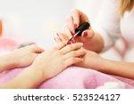 nail care in salon. selective... | Shutterstock . vector #523524127