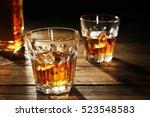 glasses of whisky on wooden... | Shutterstock . vector #523548583