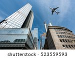 Small photo of Frankfurt skyscrapers buildings and a plane flying overhead in morning at Frankfurt, Germany.
