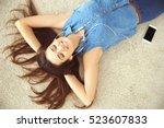 beautiful girl relaxing on floor   Shutterstock . vector #523607833