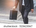 businessman the stairs in a... | Shutterstock . vector #523623067