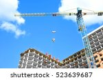 crane and building under... | Shutterstock . vector #523639687