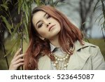 young female posing outside | Shutterstock . vector #523645087