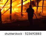 firefighters extinguish a house | Shutterstock . vector #523692883