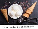 ice cream scoops on dark... | Shutterstock . vector #523702273