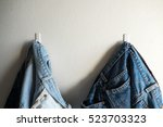 hanging jeans on the wall | Shutterstock . vector #523703323