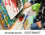 a child draws a picture paints... | Shutterstock . vector #523758457