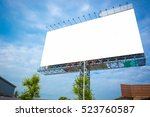 Small photo of Blank white billboard under blue sky - can advertisement for display or montage product and business