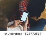 hipster girl using mobile phone ... | Shutterstock . vector #523773517