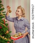 Small photo of portrait of nice young woman hanging around christmas tree on x-mas eve