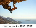 young man climbing on roof in... | Shutterstock . vector #523812787