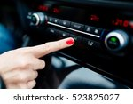 woman turns on air conditioning ... | Shutterstock . vector #523825027