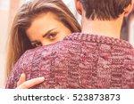 attractive girl hugging her... | Shutterstock . vector #523873873