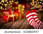 children feet in christmas...   Shutterstock . vector #523883947