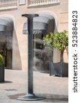 sprinklers splashing vaporized... | Shutterstock . vector #523884823